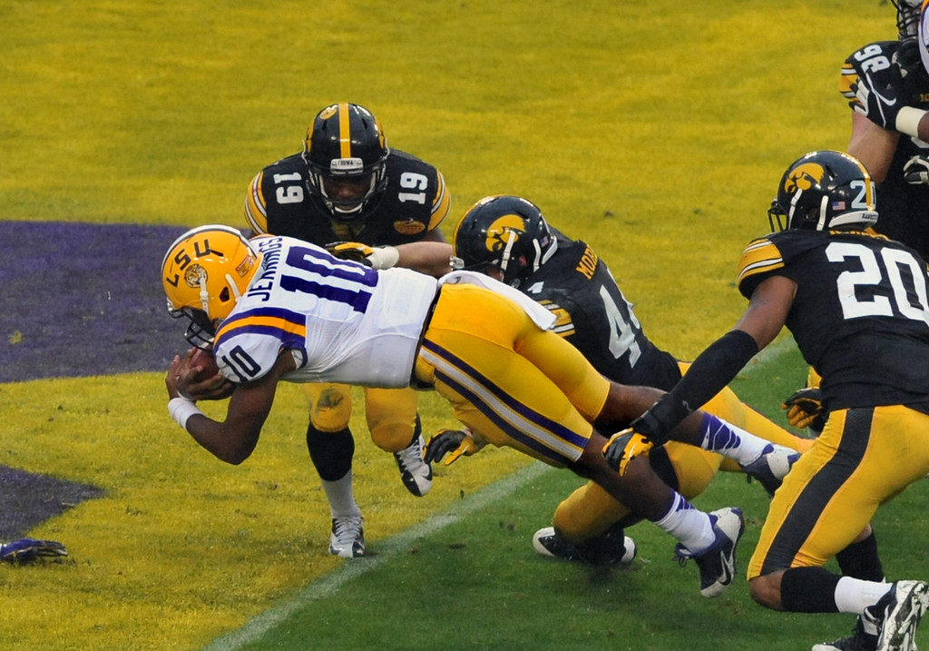 . Quarterback Anthony Jennings #10 of the LSU Tigers dives for a 3-yard touchdown in the first quarter against the Iowa Hawkeyes January 1, 2014  in the Outback Bowl at Raymond James Stadium in Tampa, Florida.  (Photo by Al Messerschmidt/Getty Images)