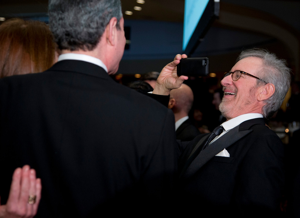 . Director Steven Spielberg uses his smart phone during the White House Correspondents\' Association Dinner at the Washington Hilton Hotel, Saturday, April 27, 2013, in Washington.  (AP Photo/Carolyn Kaster)