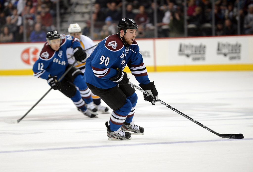 . DENVER, CO. - MARCH 30: Ryan O\'Reilly of Colorado Avalanche (#90) controls the pack in the 3rd period of the game against Nashville Predators at Pepsi Center. Denver, Colorado. March 30, 2013. (Photo By Hyoung Chang/The Denver Post)