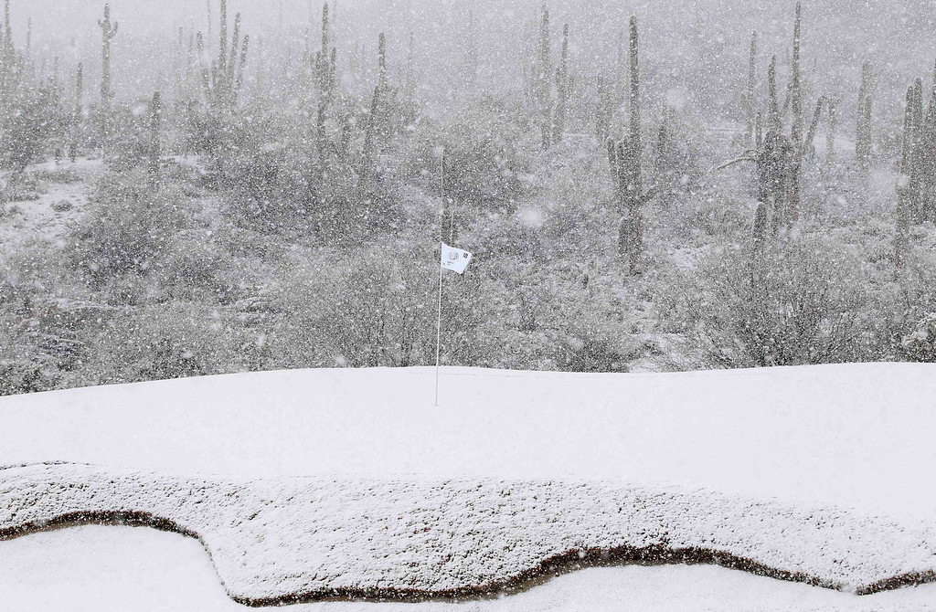 . The 18th green is covered in snow as play was suspended during the first round of the WGC-Accenture Match Play Championship golf tournament in Marana, Arizona February 20, 2013. Play was suspended at 1807 GMT because of driving rain and snow in the opening round of the WGC-Accenture Match Play Championship on Wednesday. REUTERS/Matt Sullivan