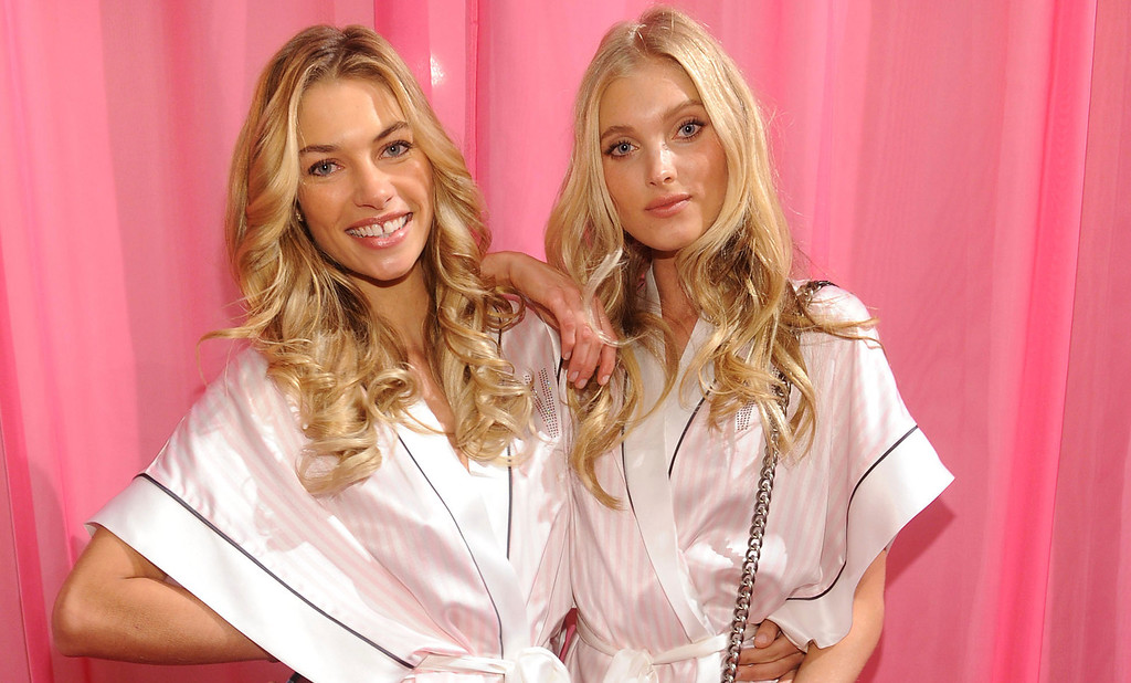 . Models Jessica Hart and Elsa Hosk prepare at the 2013 Victoria\'s Secret Fashion Show hair and makeup room at Lexington Avenue Armory on November 13, 2013 in New York City.  (Photo by Jamie McCarthy/Getty Images)