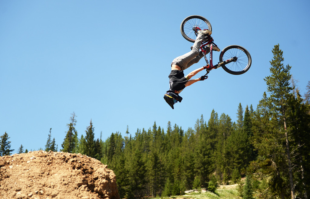 . WINTER PARK, CO. - July 26: Mike Montgomery catches air during FMB Gold Slopestyle Open Training of First international Enduro World Cup Championship ever in U.S. at Winter Park, Colorado. July 26, 2013. (Photo By Hyoung Chang/The Denver Post)