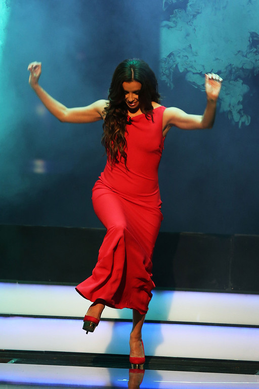 . Eva Longoria trips during the awards show for the 2013 Laureus World Sports Awards at the Theatro Municipal Do Rio de Janeiro on March 11, 2013 in Rio de Janeiro, Brazil.  (Photo by Ian Walton/Getty Images For Laureus)