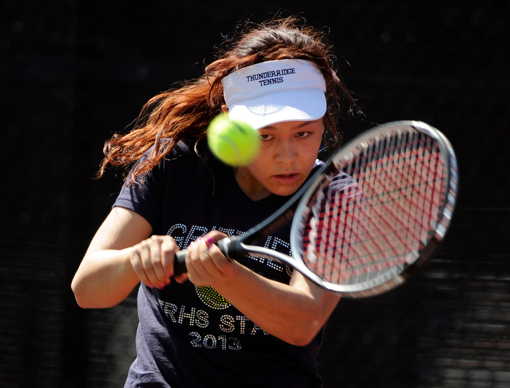 . Angelica Buczynski from ThunderRidge High School returns the ball to Katie Li from Fairview High School in the #3 Singles Bracket. The State 5A Girls\' Tennis Championships at the Gates Tennis Center. (Photo By Kathryn Scott Osler/The Denver Post)