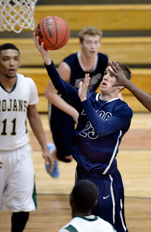 . Eagles\' senior Garrett Baggett (23) drove the lane through traffic in the second half. The Valor Christian High School boy\'s basketball team defeated Aurora Central 60-52 Wednesday night, January 8, 2014. Photo By Karl Gehring/The Denver Post