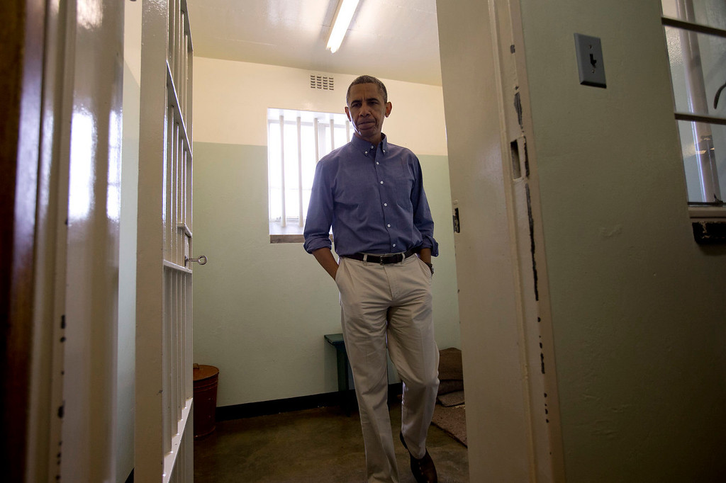 . U.S. President Barack Obama walks from Section B, prison cell No. 5, on Robben Island, South Africa, Sunday, June 30, 2013. This was former South African president Nelson Mandela\'s cell where he spent 18 years of his 27-year prison term locked up by the former apartheid government. (AP Photo/Carolyn Kaster)