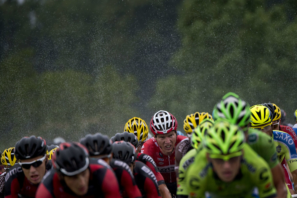 . The pack rides under a heavy rain during the 208.5 km nineteenth stage of the 101st edition of the Tour de France cycling race on July 25, 2014 between Maubourguet Pays du Val d\'Adour and Bergerac, southwestern France.  AFP PHOTO / JEFF  PACHOUD/AFP/Getty Images
