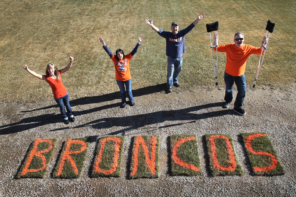 . Green Valley Turf Co. office staff cheers for the Broncos. The sign is make out of slabs of sod Friday outside our Littleton office.