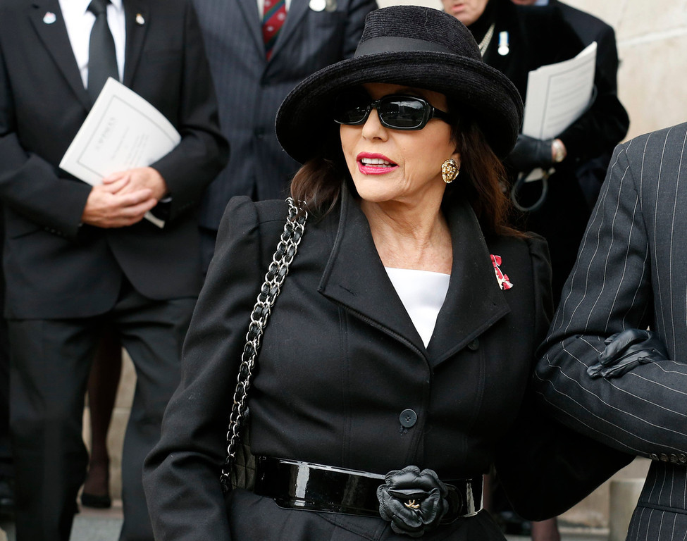 . Actress Joan Collins leaves after attending the funeral service of former British Prime Minister Margaret Thatcher at St Paul\'s Cathedral, in London April 17, 2013. Thatcher, who was Conservative prime minister between 1979 and 1990, died on April 8 at the age of 87.  (AP Photo/Olivia Harris, pool)