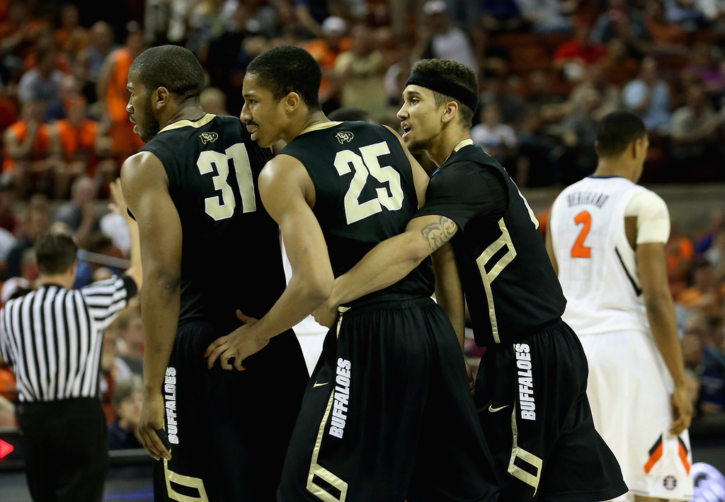 . AUSTIN, TX - MARCH 22:  (L-R) Andre Roberson #31, Spencer Dinwiddie #25 and Askia Booker #0 of the Colorado Buffaloes celebrate during the game against the Illinois Fighting Illini during the second round of the 2013 NCAA Men\'s Basketball Tournament at The Frank Erwin Center on March 22, 2013 in Austin, Texas.  (Photo by Stephen Dunn/Getty Images)