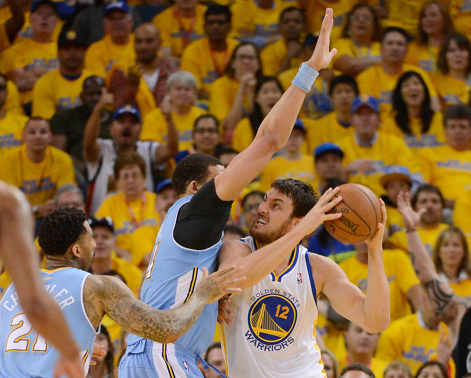. JaVale McGee (34) of the Denver Nuggets blocks out Andrew Bogut (12) of the Golden State Warriors during the second quarter in Game 6 of the first round NBA Playoffs May 2, 2013 at Oracle Arena. (Photo By John Leyba/The Denver Post)