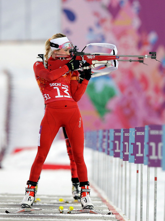 . Switzerland\'s Elisa Gasparin shoots during the mixed biathlon relay at the 2014 Winter Olympics, Wednesday, Feb. 19, 2014, in Krasnaya Polyana, Russia. (AP Photo/Lee Jin-man)