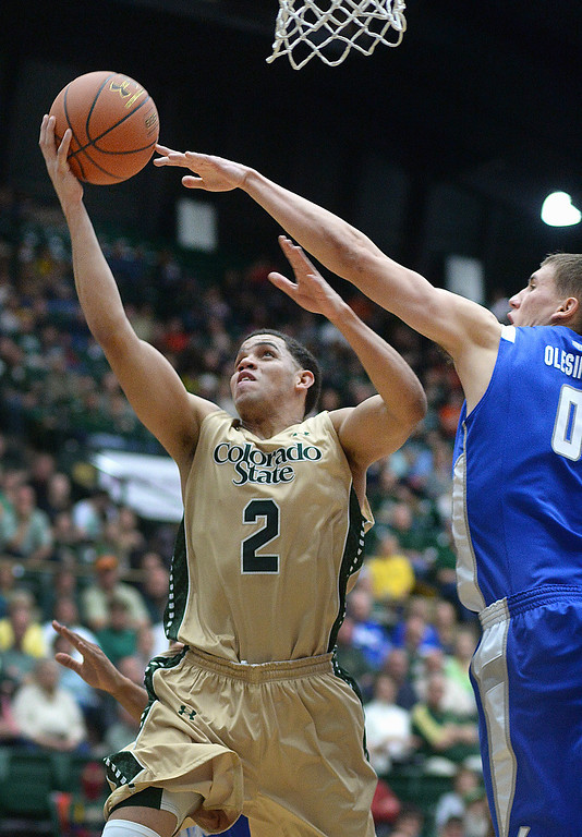 . FORT COLLINS, CO. - JANUARY 18: Colorado State junior guard Daniel Bejarano (2) tried to get around Falcons\' defender Marek Olesinski (0)  in the second half. The Colorado State men\'s basketball team defeated Air Force 74-68 at Moby Arena in Fort Collins Saturday night, January 18, 2014. Photo By Karl Gehring/The Denver Post