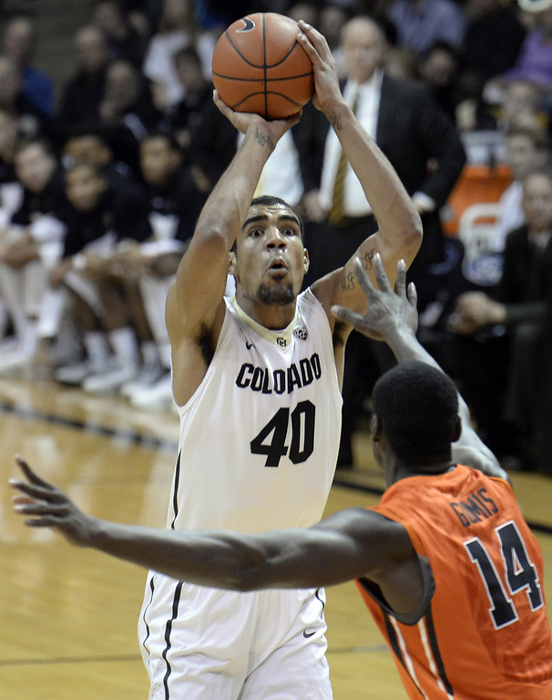. Colorado\'s Josh Scott takes a shot over Oregon State\'s Daniel Gomis during an NCAA college basketball game Thursday, Jan. 2, 2014, in Boulder, Colo. Jeremy Papasso/Daily Camera