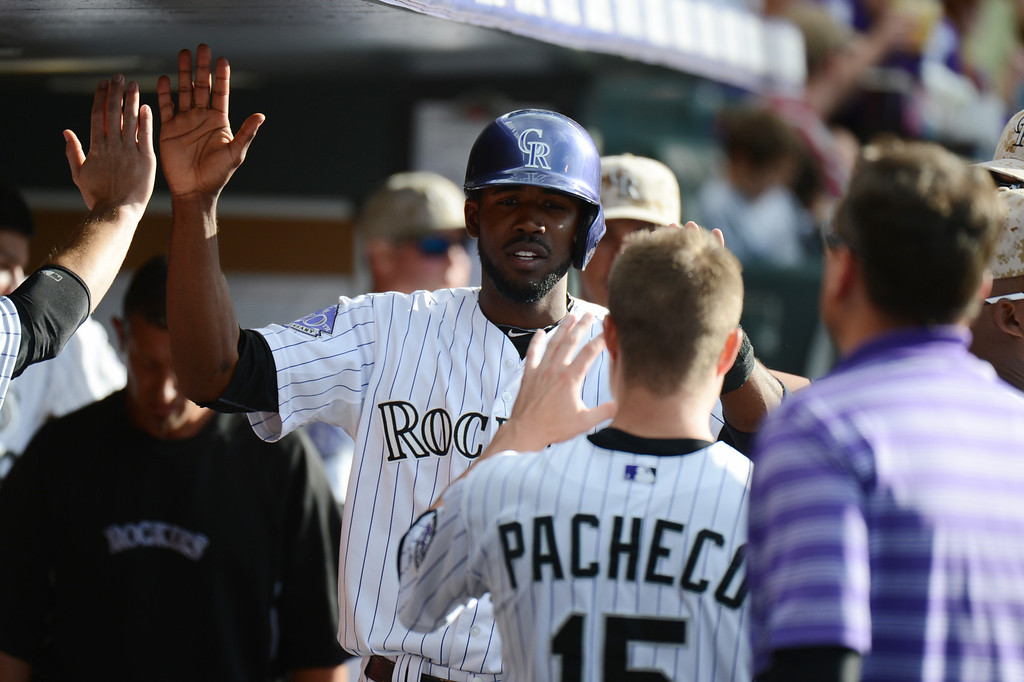 . Denver, CO. - June 08: Dexter Fowler of Colorado Rockies (24) celebrate scoring in the 3rd inning of the game against San Diego Padres at Coors Field. Denver, Colorado. June 8, 2013.  (Photo By Hyoung Chang/The Denver Post)