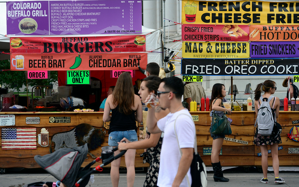 . DENVER, CO - AUGUST 29: Hungry visitors make their way to the opening day of A Taste of Colorado at Civic Center Park in downtown Denver on Friday, Aug. 29, 2014. The food and music festival runs through Labor Day Weekend. (Kathryn Scott Osler/The Denver Post)