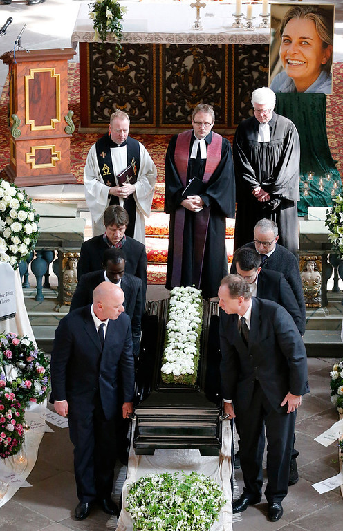 . The coffin is being carried after the funeral service for Associated Press photojournalist Anja Niedringhaus in Hoexter, Germany, Saturday, April 12, 2014. Niedringhaus was killed by an Afghan policeman in an attack on April 4, 2014 in Afghanistan. (AP Photo/Frank Augstein, pool)