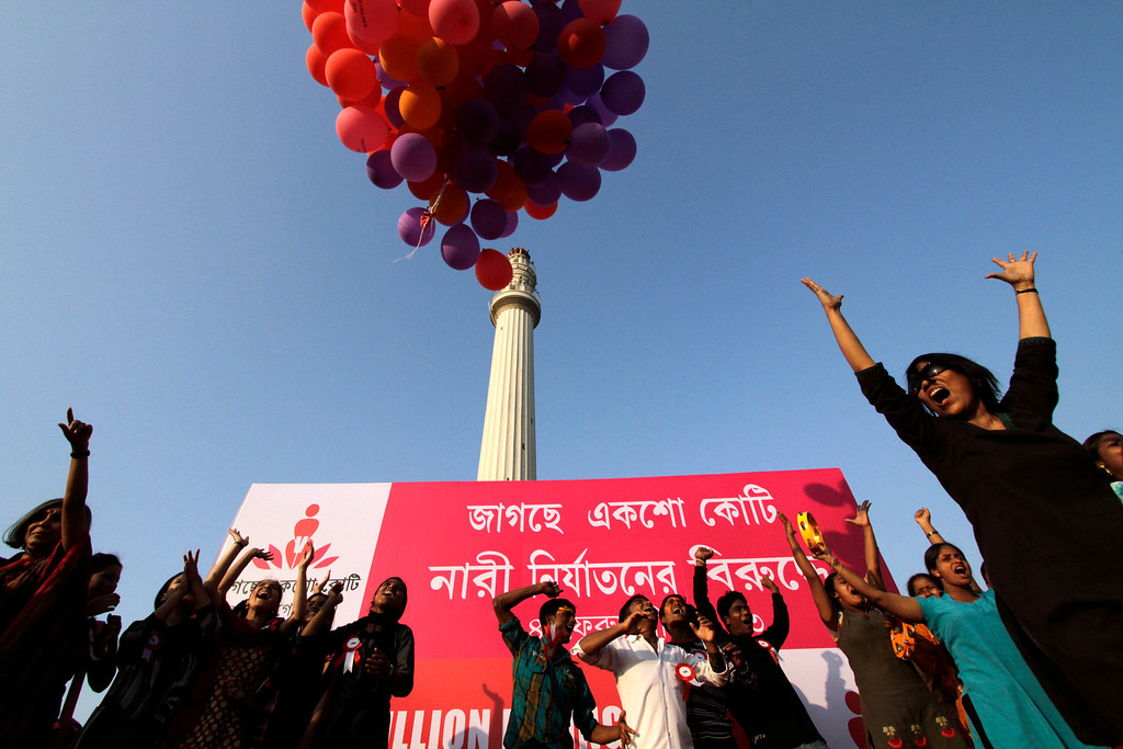 """. Activists release balloons during an event to support \""""One Billion Rising\"""" global campaign in Kolkata, India, Thursday, Feb. 14, 2013. Flashmobs, rallies with singing and dancing were organized across the country as part of the campaign, timed to coincide with Valentine\'s Day, to bring an end to violence against women. (AP Photo/Bikas Das)"""
