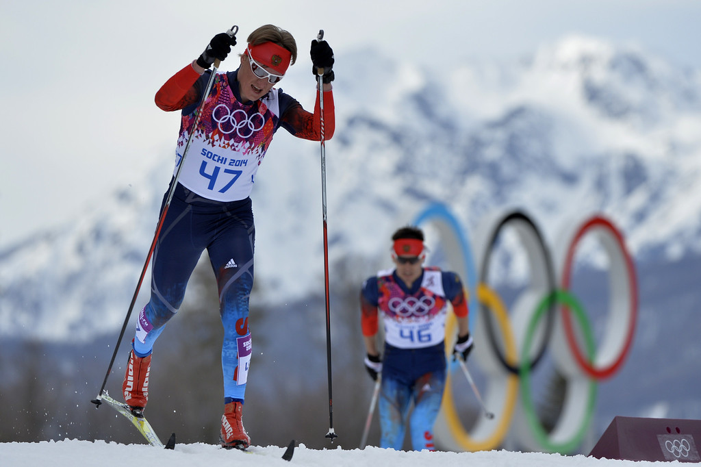 . Russia\'s Dmitriy Japarov (47) and Russia\'s Evgeniy Belov (46) compete in the Men\'s Cross-Country Skiing 15km Classic at the Laura Cross-Country Ski and Biathlon Center during the Sochi Winter Olympics on February 14, 2014 in Rosa Khutor near Sochi. AFP PHOTO / ODD ANDERSEN/AFP/Getty Images
