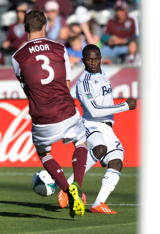 . COMMERCE CITY, CO. - OCTOBER 19: Colorado defender Drew Moor (3) blocked an attempt made by Vancouver forward Kekuta Manneh (23) in the first half. The Colorado Rapids hosted the Vancouver Whitecaps at Dick\'s Sporting Goods Park Saturday, October 19, 2013. Photo By Karl Gehring/The Denver Post