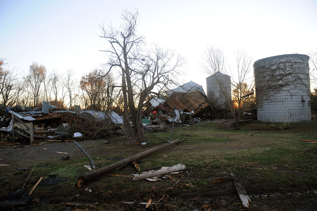 . Debris lies on the ground in Brookport, Ill., Monday, Nov. 18, 2013, after a tornado moved through the area. An unusually large and strong late-season storm system ripped through several states across the Midwest on Sunday, spawning tornadoes and tearing through homes and overturning cars along its path. (AP Photo/Stephen Lance Dennee)