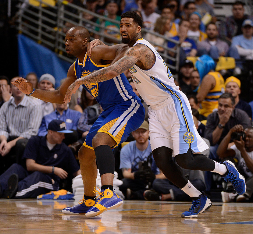 . Denver Nuggets shooting guard Wilson Chandler (21) play defense on Golden State Warriors power forward Carl Landry (7) in the first quarter. The Denver Nuggets took on the Golden State Warriors in Game 5 of the Western Conference First Round Series at the Pepsi Center in Denver, Colo. on April 30, 2013. (Photo by John Leyba/The Denver Post)