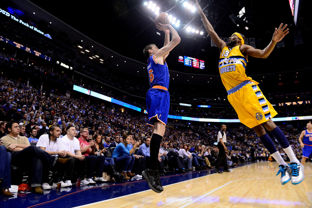 . DENVER, CO - MARCH 13: Corey Brewer (13) of the Denver Nuggets attempts a block on Steve Novak (16) of the New York Knicks during the first half of action. The Denver Nuggets play the New York Knicks at the Pepsi Center. (Photo by AAron Ontiveroz/The Denver Post)