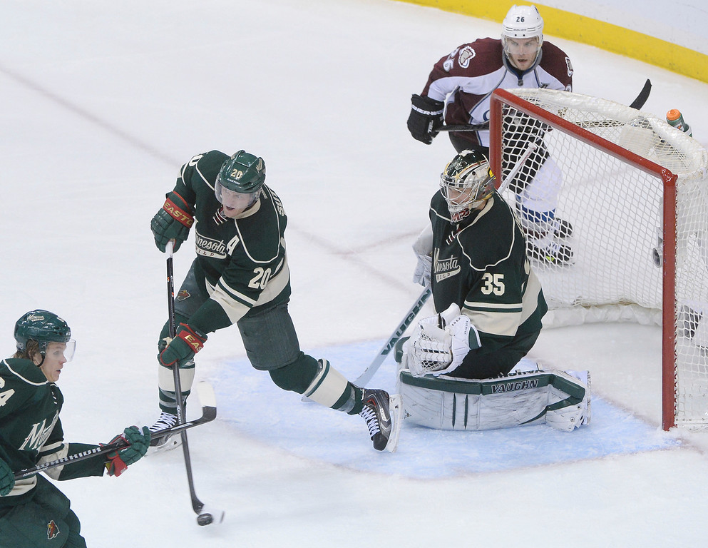 . Minnesota defenseman Ryan Suter (20) cleared the puck away from the net in the third period.   (Photo by Karl Gehring/The Denver Post)