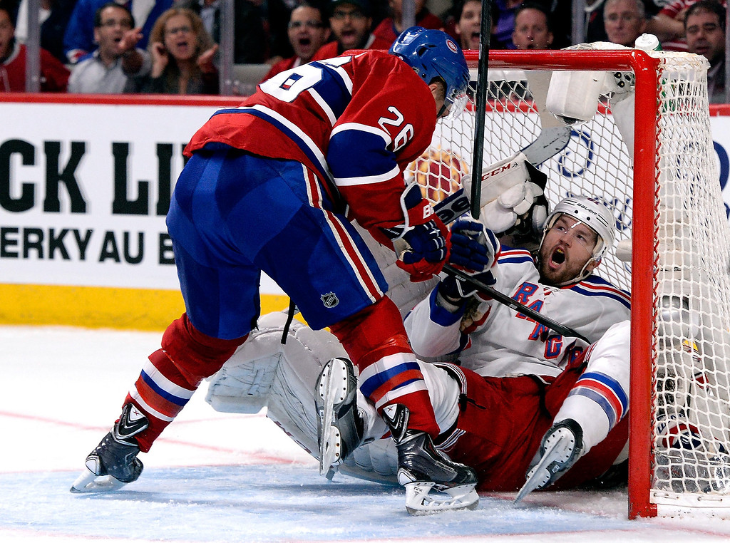 . Rick Nash #61 of the New York Rangers crashes into Dustin Tokarski #35 of the Montreal Canadiens during Game Five of the Eastern Conference Final in the 2014 NHL Stanley Cup Playoffs at Bell Centre on May 27, 2014 in Montreal, Canada.  (Photo by Richard Wolowicz/Getty Images)