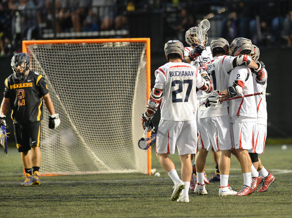 . United States attack Brendan Mundorf celebrated with teammates after he scored on Iroquois goalie Marty Ward in the fourth quarter. The United States defeated the Iroquois Nationals 18-5 Tuesday night, July 15, 2014.   Photo by Karl Gehring/The Denver Post