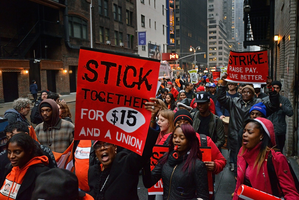 . Fast food workers and union members demonstrate calling for an increase in the minimum hourly wage to 15 US dollars and the right of workers to join unions, in New York, USA, 05 December 2013.  EPA/PETER FOLEY