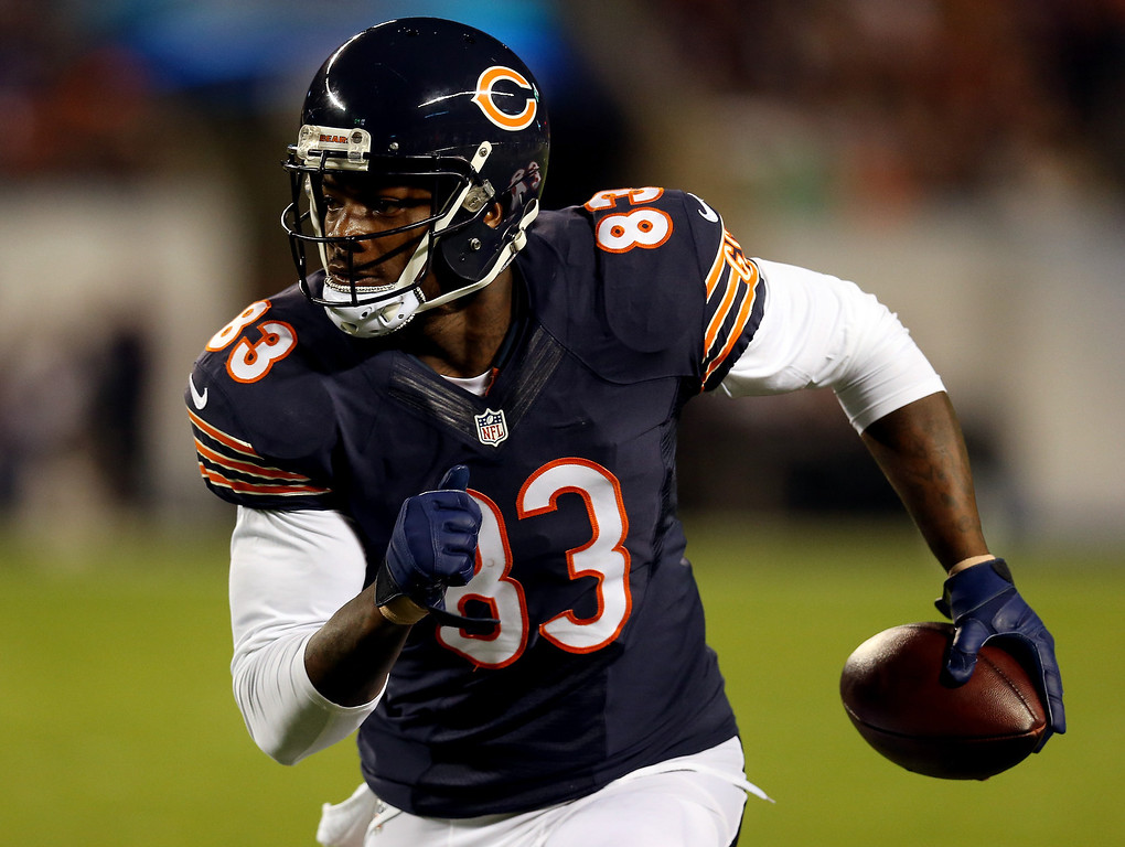. Tight end Martellus Bennett #83 of the Chicago Bears runs with the ball after a reception against the New York Giants during a game at Soldier Field on October 10, 2013 in Chicago, Illinois.  (Photo by Jonathan Daniel/Getty Images)