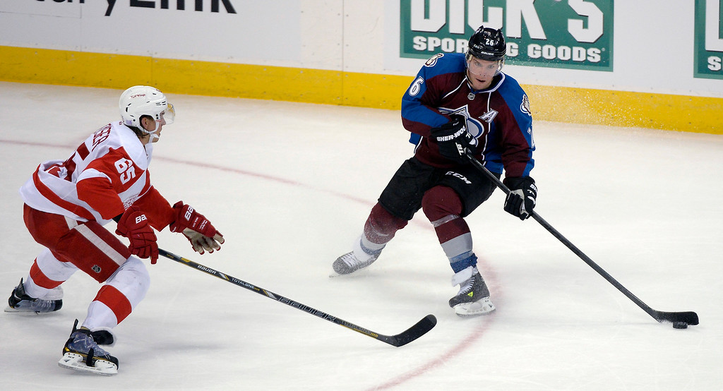 . Colorado Avalanche center Paul Stastny (26) skates the puck in the zone as Detroit Red Wings defenseman Danny DeKeyser (65) gets back on defense during the third period October 17, 2013 at Pepsi Center.(Photo by John Leyba/The Denver Post)