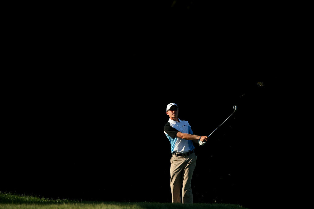 . Mackenzie Hughes of Canada hits his second shot on the tenth hole during the continuation of Round Two of the 113th U.S. Open at Merion Golf Club on June 15, 2013 in Ardmore, Pennsylvania.  (Photo by Andrew Redington/Getty Images)