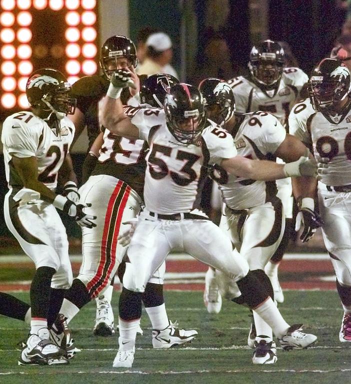 . Denver Broncos\' Bill Romanowski celebrates after sacking Falcon\'s quarterback Chris Chandler in the opening drive of Super Bowl XXXIII in Miami Sunday, Jan. 31, 1999. (AP Photo/Bob Galbraith)