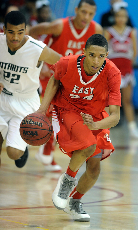 . DENVER, CO. - FEBRUARY 16: East guard Dominique Collier (24) headed to the basket with a turnover in the second half. The Denver East High School boy\'s basketball team defeated George Washington 82-20 Saturday afternoon, February 16, 2013.  (Photo By Karl Gehring/The Denver Post)