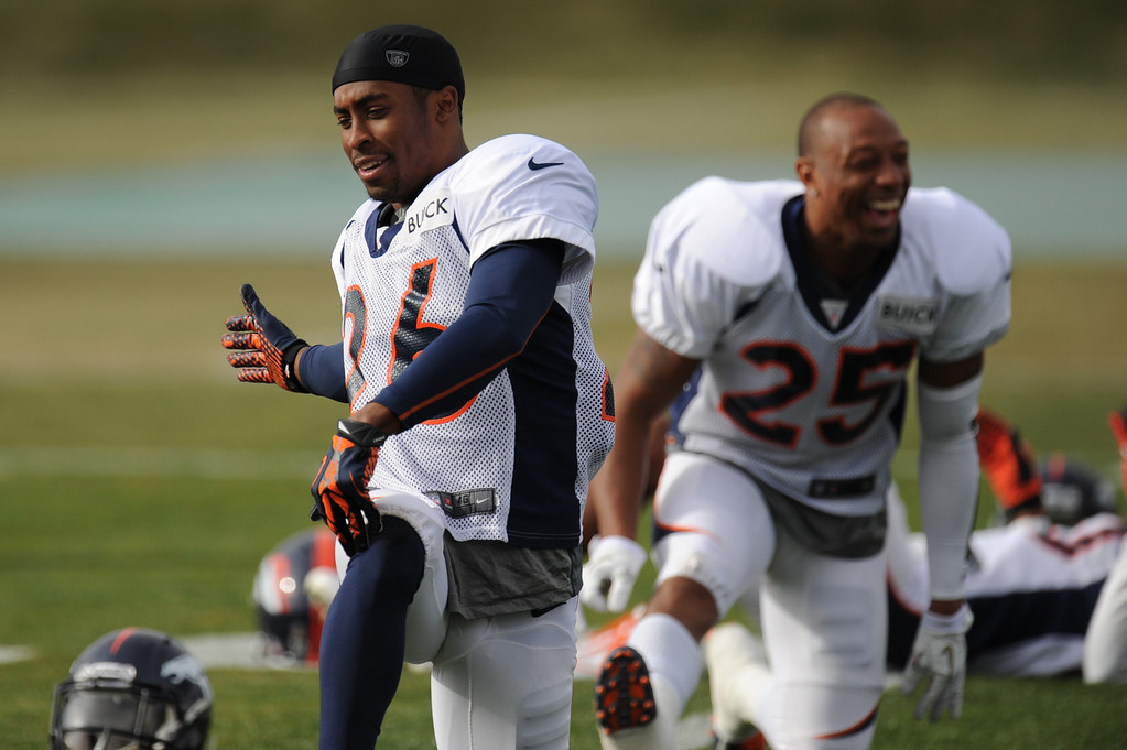 . Denver Broncos free safety Rahim Moore #26 and cornerback Chris Harris #25 stretching during Broncos practice for their coming game against the Tampa Bay Buccaneers at Dove Valley in Denver Colorado Wednesday, November 28,  2012.    Joe Amon, The Denver Post