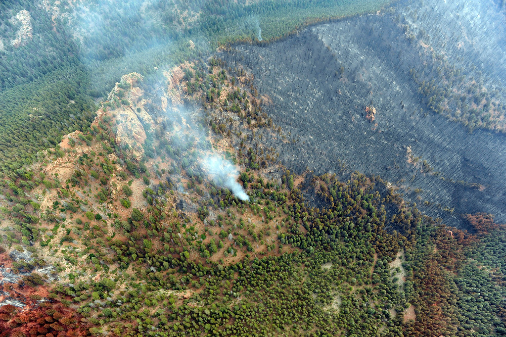 . An aerial photo, Thursday June 28, 2012, of the Waldo Canyon fire in Colorado Springs shows the destructive path of the fire in Mountain Shadows Subdivision area. RJ Sangosti, The Denver Post
