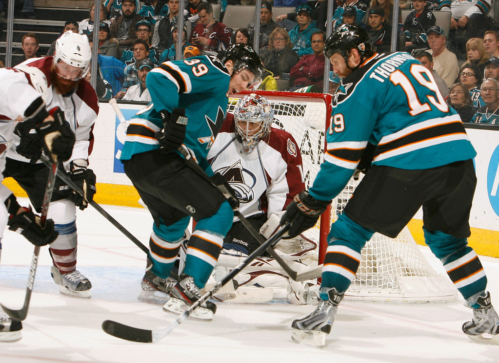 . SAN JOSE, CA - JANUARY 26: Joe Thornton #19 and Logan Couture #39 of the San Jose Sharks try to score against Semyon Varlamov #1 of the Colorado Avalanche during an NHL game on January 26, 2013 at HP Pavilion in San Jose, California. (Photo by Don Smith/NHLI via Getty Images)