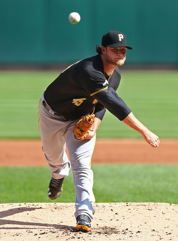 . Pittsburgh Pirates pitcher Gerrit Cole throws against the St. Louis Cardinals in the first inning of Game 2 of baseball\'s National League division series on Thursday, Oct. 3, 2013, in St. Louis. (AP Photo/Elsa, Pool)
