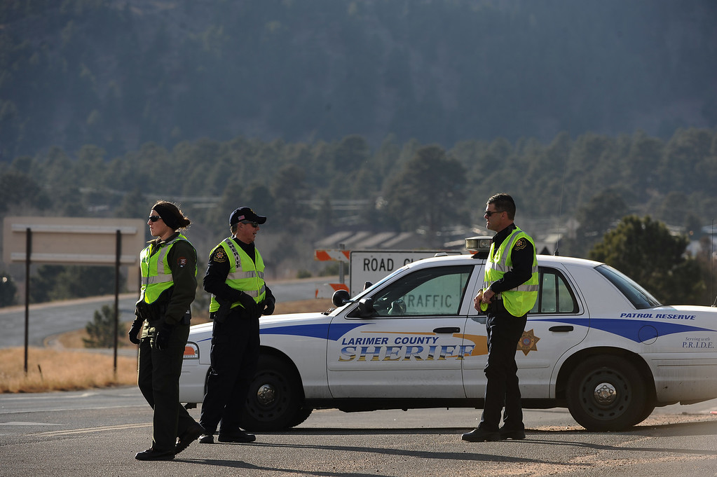 . Deputy sheriff\'s from Larimer County keep the road closed into Rocky Mountain National Park on December 2, 2012. The Fern Lake Fire, which has been burning in Rocky Mountain National Park since October, kicked up yesterday and forced the evacuation of hundreds of homes east of the fire on December 2, 2012. Helen H. Richardson, The Denver Post
