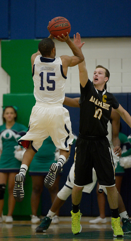 . AURORA, CO - FEBRUARY 12: Overland Austin Conway (5) takes over Arapahoe Corbin Atwell  (10) during their 5A basketball game February 12, 2014 in Aurora. (Photo by John Leyba/The Denver Post)