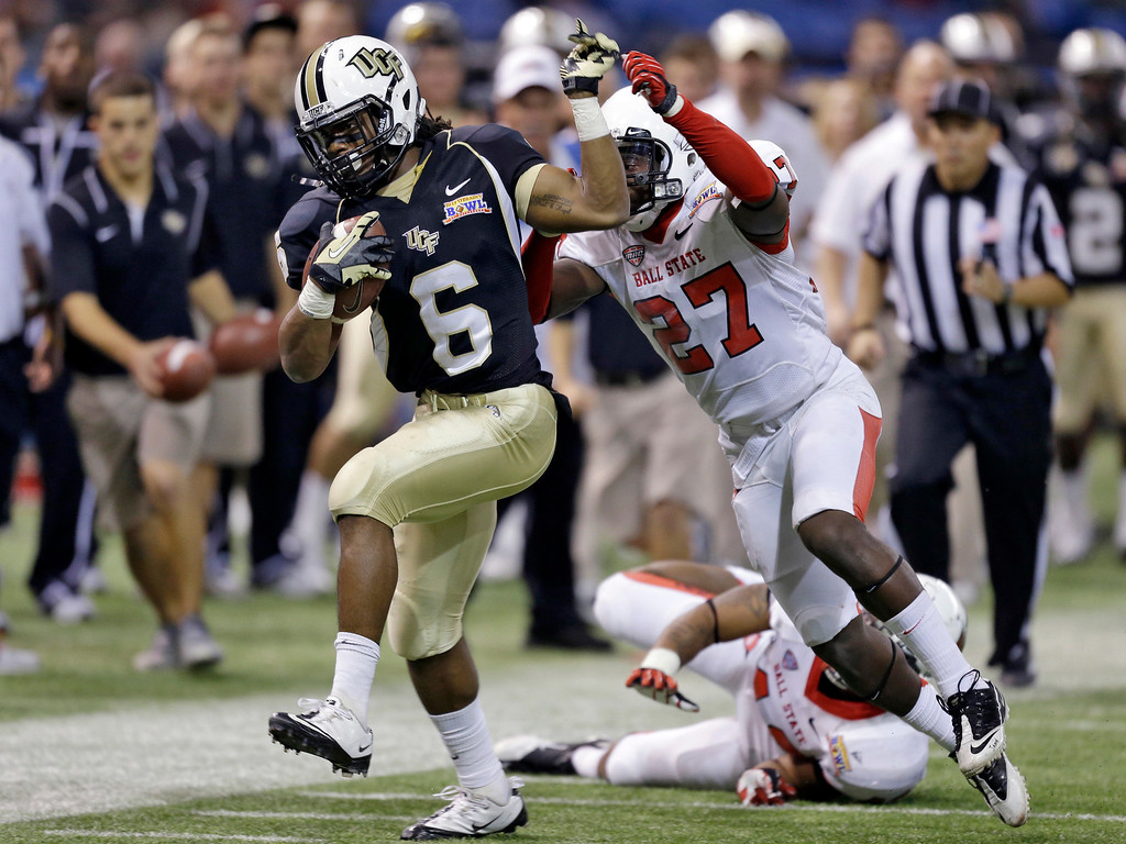 . Central Florida wide receiver Rannell Hall (6) gets past Ball State safety J.C. Wade (27) after a reception during the third quarter of the Beef \'O\' Brady\'s Bowl NCAA college football game Friday, Dec. 21, 2012, in St Petersburg, Fla. Central Florida won 38-17. (AP Photo/Chris O\'Meara)