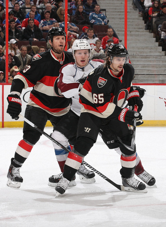. Marc Methot #3 and Erik Karlsson #65 of the Ottawa Senators defend against Gabriel Landeskog #92 of the Colorado Avalanche during an NHL game at Canadian Tire Centre on March 16, 2014 in Ottawa, Ontario, Canada.  (Photo by Jana Chytilova/Freestyle Photography/Getty Images)