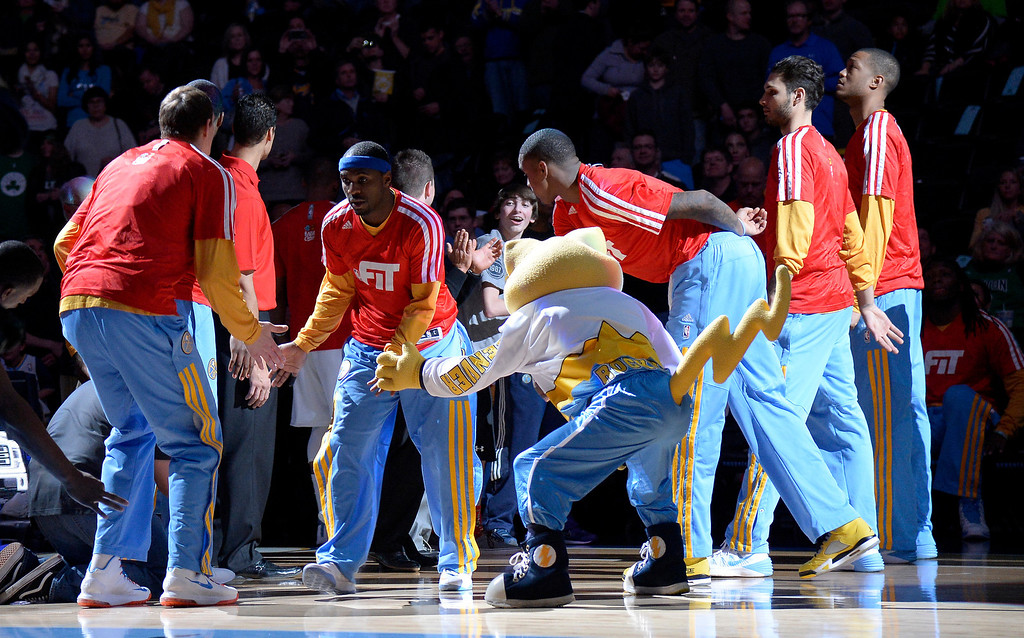 . Denver Nuggets point guard Ty Lawson (3) gets introduced during player introductions against the Boston Celtics January 7, 2014 at Pepsi Center. (Photo by John Leyba/The Denver Post)