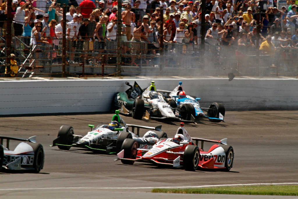 . Ed Carpenter (20) and James Hinchcliffe, (27) of Canada, crash in the first turn during the 98th running of the Indianapolis 500 IndyCar auto race at the Indianapolis Motor Speedway in Indianapolis, Sunday, May 25, 2014. (AP Photo/Steve Metz)