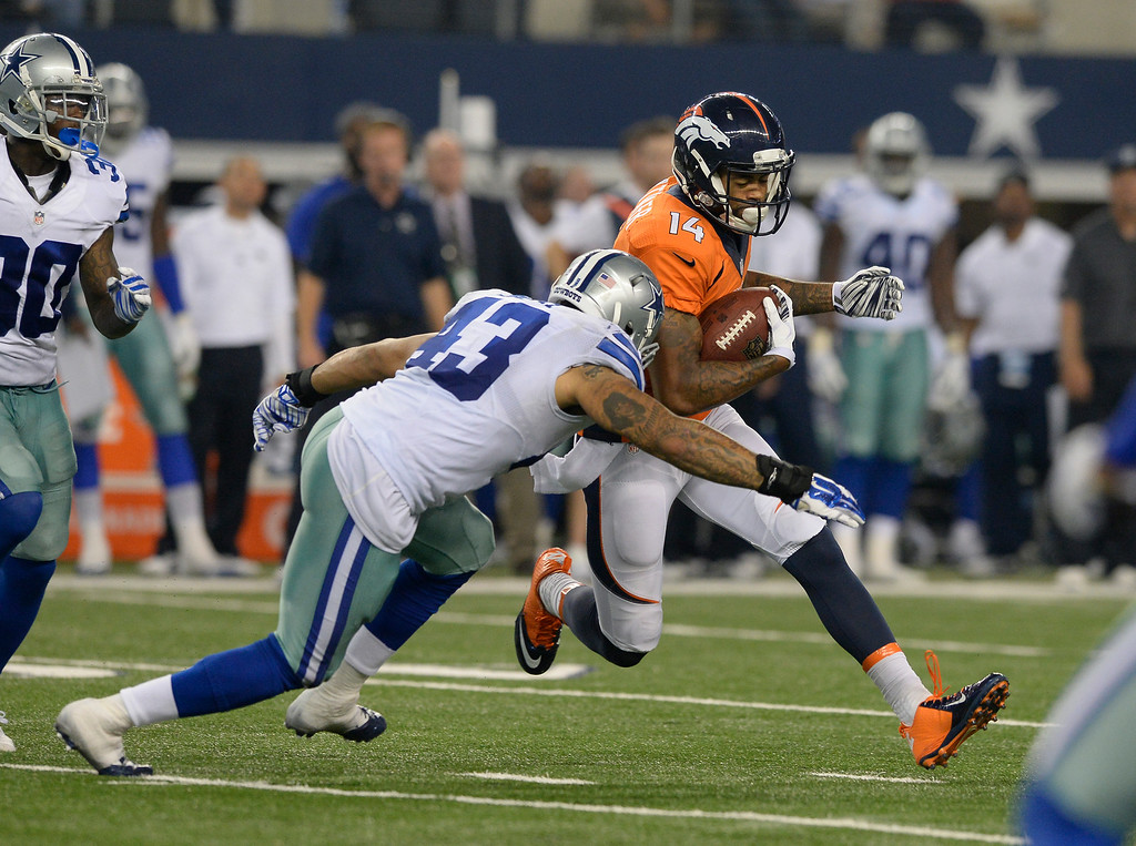 . ARLINGTON, TX - AUGUST 28: Dallas Cowboys linebacker Keith Smith (43) puts a hit on Denver Broncos wide receiver Cody Latimer (14) after a short gain during the fourth quarter August 28, 2014 at AT&T Stadium. (Photo by John Leyba/The Denver Post)