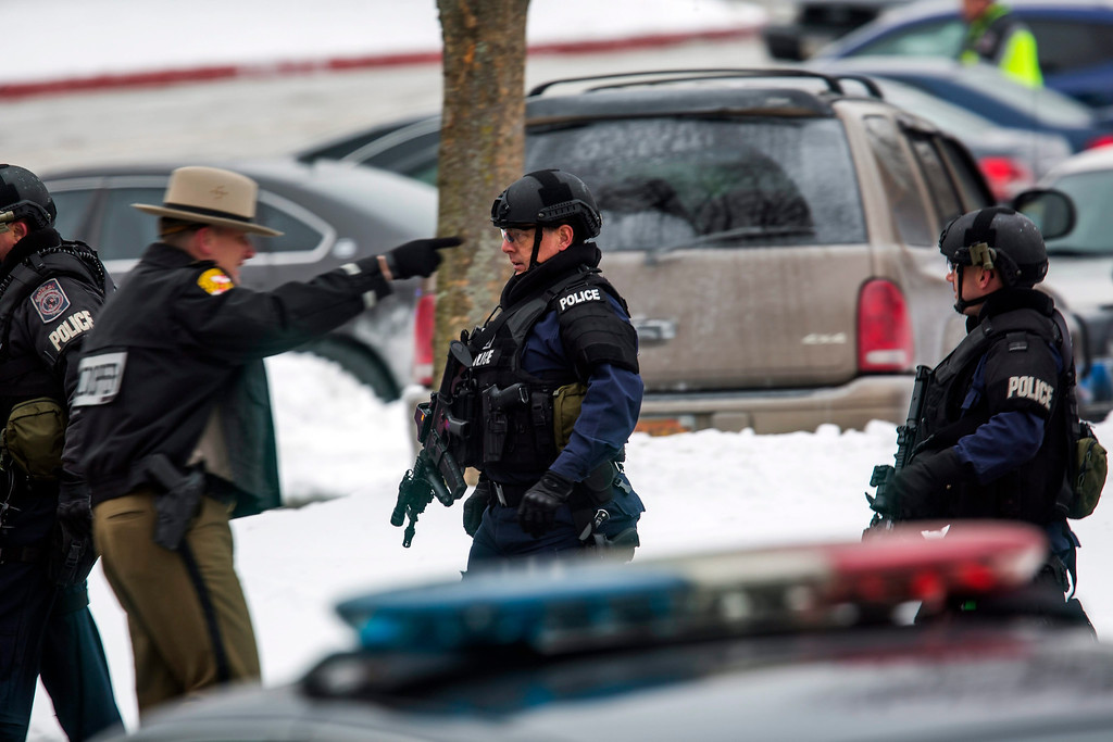 . Police prepare to enter the Columbia Mall after a gunman killed three people, including himself, in the food court of the mall in Columbia, Maryland, USA, 25 January 2014. Police were confident it was a single shooter, said Bill McMahon, chief of Howard County police, in broadcast remarks. Many in the weekend shopping crowd took cover and found hiding places, as the general public has been instructed to do. Police were scouring the mall to find anyone still sheltering, police said.  EPA/JIM LO SCALZO