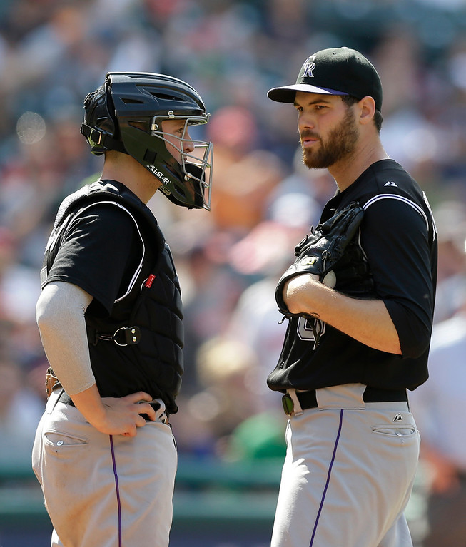 . Colorado Rockies relief pitcher Adam Ottavino, right, talks with catcher Jordan Pacheco during the ninth inning of a baseball game against the Cleveland Indians, Sunday, June 1, 2014, in Cleveland. The Indians defeated the Rockies 6-4. (AP Photo/Tony Dejak)