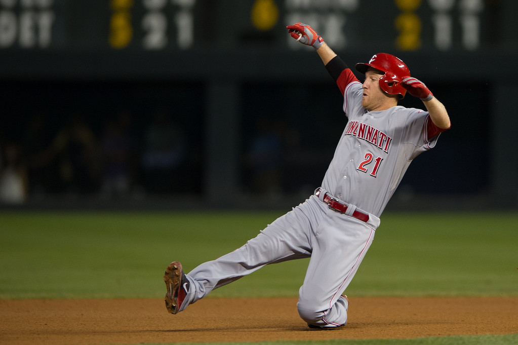 . DENVER, CO - AUGUST 30:  Todd Frazier #21 of the Cincinnati Reds slides into second base as he doubles to lead off the fourth inning of a game against the Colorado Rockies at Coors Field on August 30, 2013 in Denver, Colorado. (Photo by Dustin Bradford/Getty Images)